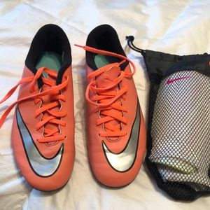 Girls Nike soccer cleats and chin pads